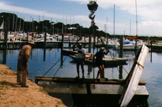 Righting an over-turned pontoon. The attached dinghy was supposed keep it upright